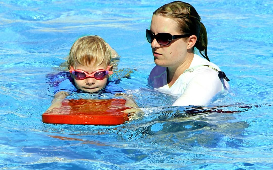 child in swim safety class